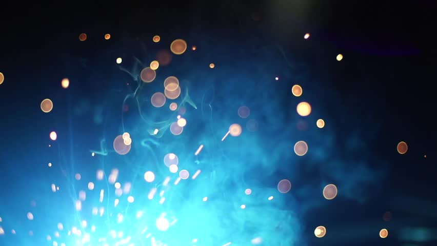 Welding sparklers particles in black background. spark super slow motion  Gold particles title background sparkles glitter particles
