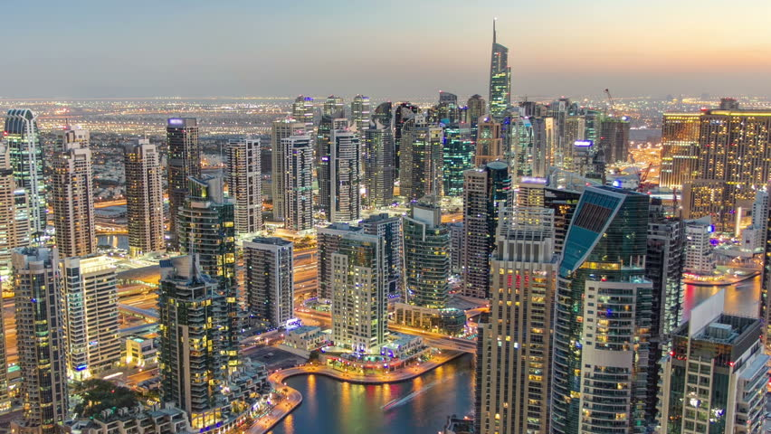 Dubai Marina with yachts in harbor and modern towers from top of skyscraper transition from day to night timelapse, Glittering lights and tallest skyscrapers during a clear evening with Blue sky. | Shutterstock HD Video #26854093