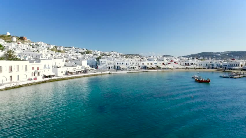 Mykonos promenade, Greek island, part of the Cyclades, Fly over water to the city and camera goes up   Shutterstock HD Video #26877733
