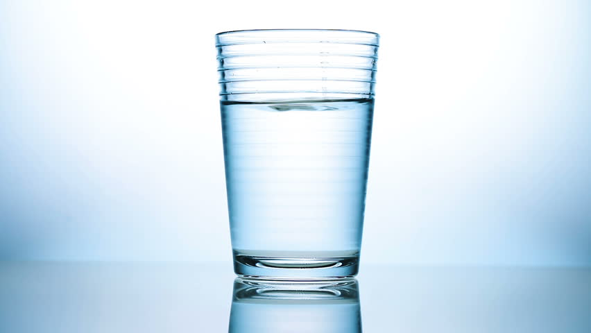 Glass of Water with Drop Stock Footage Video (100% Royalty-free) 26890606 |  Shutterstock