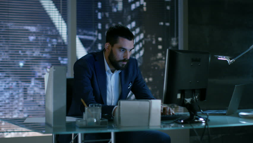 Late at Night Businessman Looses Temper Throws Everything Of His Table. He Works in a Private Office with Big City Window View.  Royalty-Free Stock Footage #26897818