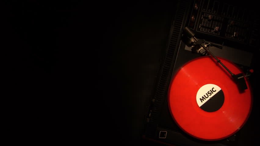 Vinyl record on the pleer. Plays a song from an old turntable 4k top view. Black background. The music round plate rotate. Music disc turn. Obsolete technology. White object with place for titles. | Shutterstock HD Video #26898400