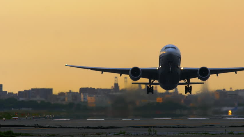 Jet plane taking off in sunset  | Shutterstock HD Video #26902378