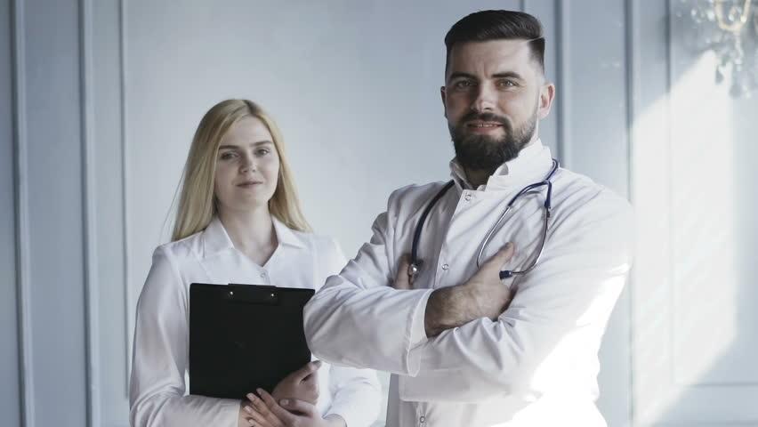 Healthcare, Medicine concept: Two Doctors Portraits Hospital. Medical Team, Slow Motion