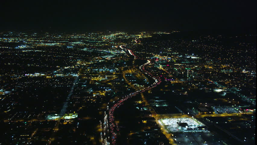Timelapse flight over Los Angeles traffic at night, then approaching airport. Shot in 2010. | Shutterstock HD Video #26909308