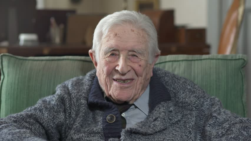 Portrait of grandfather laughing and smiling at the camera | Shutterstock HD Video #26910643