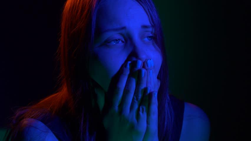 Scared teen girl with in dark   Shutterstock HD Video #26922805