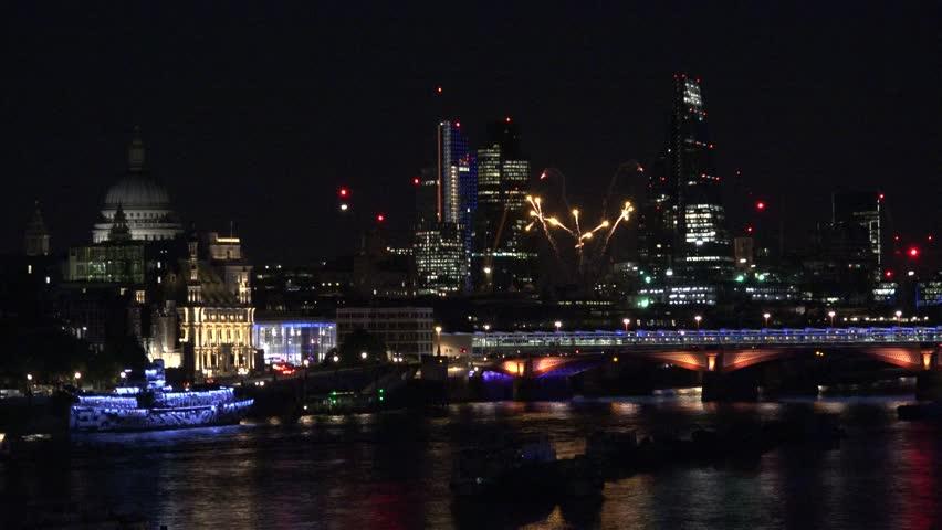 4K Beautiful firework explosion in London, city panorama with modern skyscraper emblem