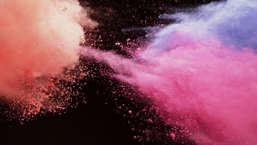 Colorful powder. red powder,pink powder,purple powder,Powder exploding against black background. Shot with high speed camera, phantom flex 4K. Slow Motion.