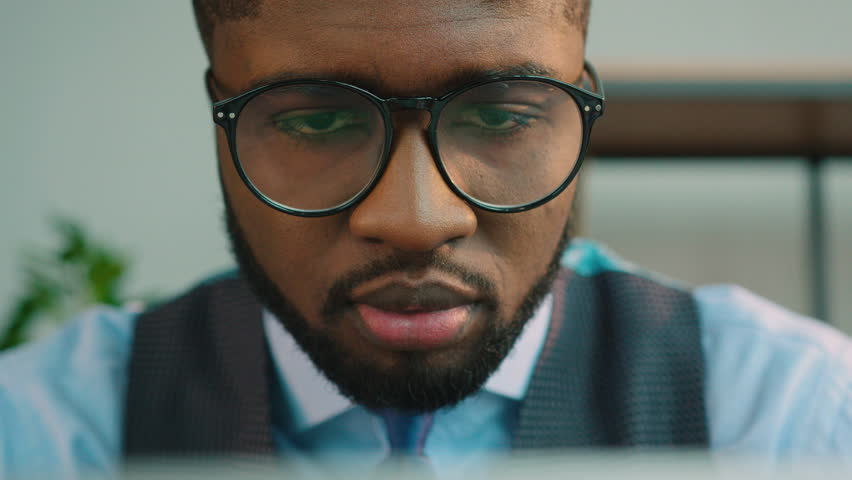 African American business man using laptop computer at the office. Black office worker typing on laptop keyboard and looking at the screen monitor. Close up #26959141