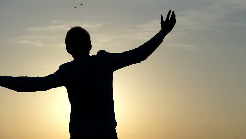Freedom in the Dance at Sunset. Man Rising Hands to the Air. the Action in Slow Motion. #26965402