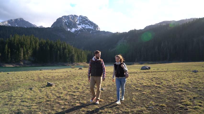 Young couple walking along the lake | Shutterstock HD Video #26991406