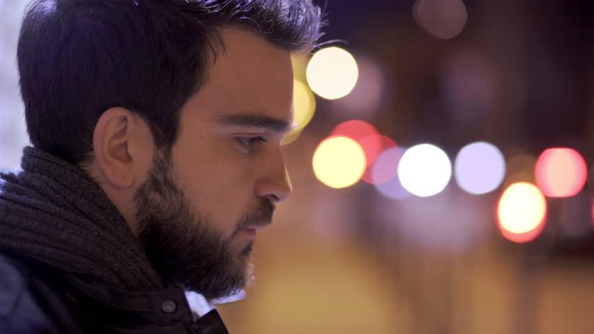 profile of Sad,depressed bearded man in city, close up #27000592
