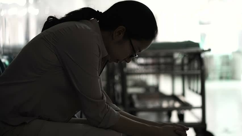 Asian woman sitting alone in hospital. Worried and  anxious from thinking of bad news 4K