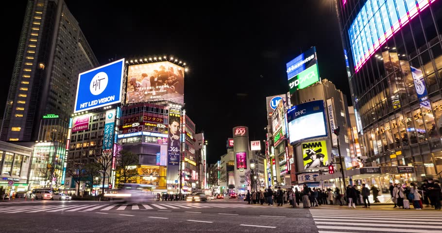 TOKYO, JAPAN - CIRCA MARCH, 2017: Shibuya crossing at night. Shibuya is known as one of the fashion centers of Japan, particularly for young people, and as a major nightlife area. Time lapse.