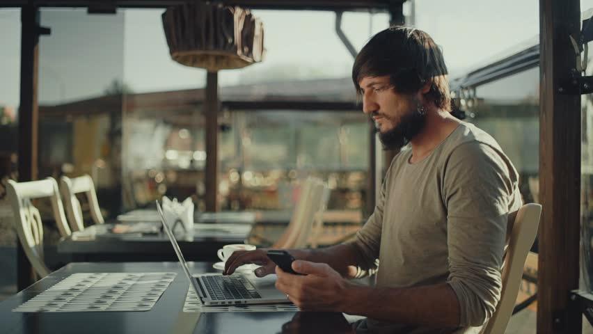 Bearded freelancer Man typing on laptop | Shutterstock HD Video #27045763