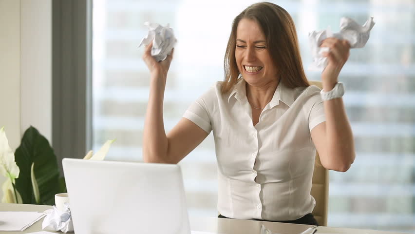 Angry furious female office worker throwing crumpled paper, having nervous breakdown at work, screaming in anger, stress management, mental distress problems, losing temper, reaction on failure  Royalty-Free Stock Footage #27047875