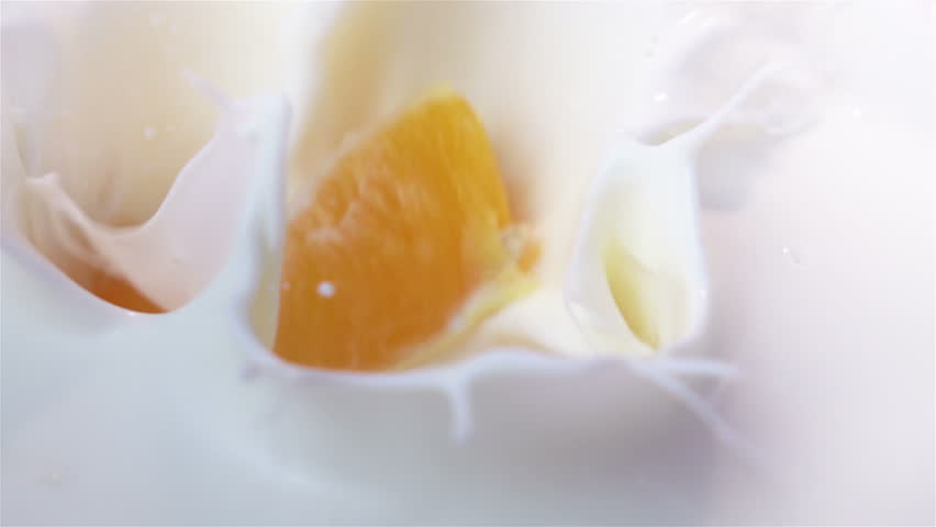 High quality video of pieces of orange falling into yogurt in real 1080p slow motion 250fps | Shutterstock HD Video #27052630