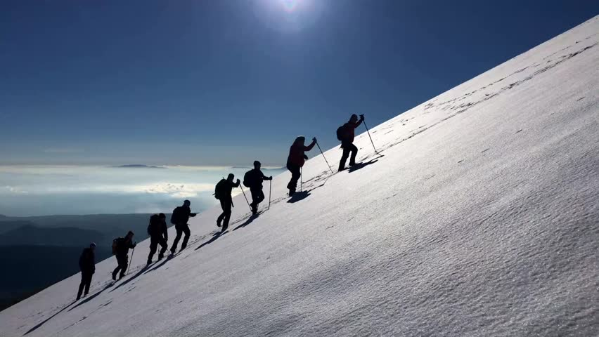 Hiking group in snowy mountains | Shutterstock HD Video #27055633