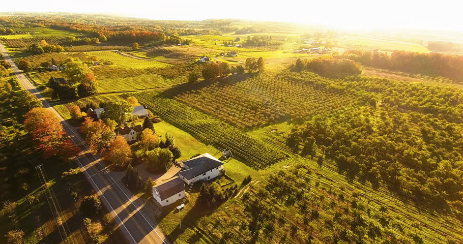 Aerial Old Mission Peninsula Drone footage over Farmhouse and Orchards