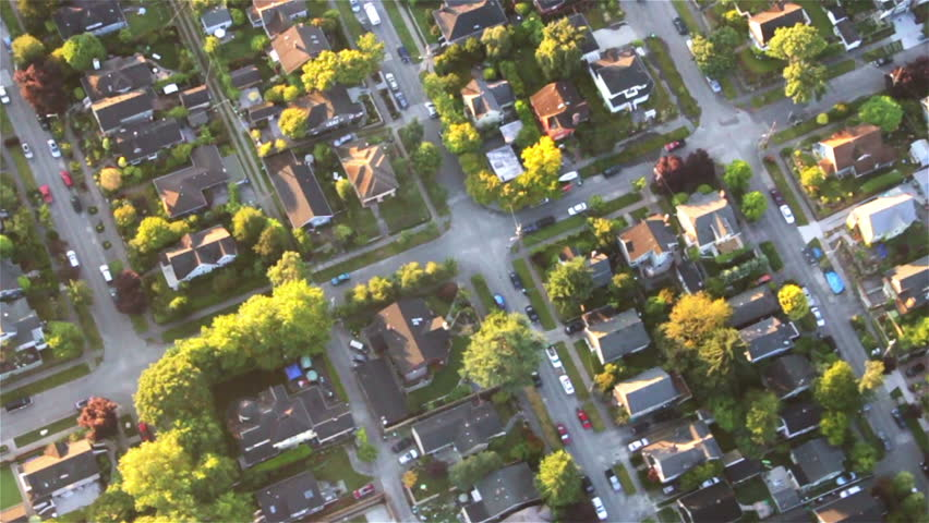 Overhead right pan across houses, yards and cars along suburban street | Shutterstock HD Video #2708816