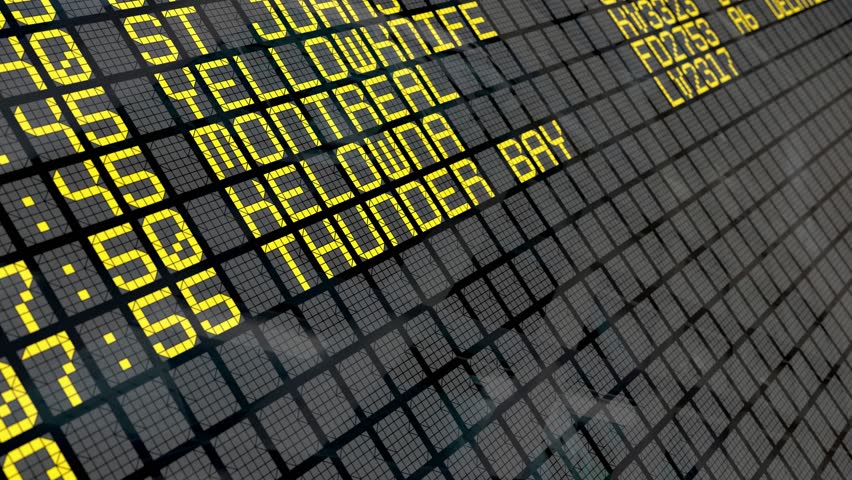 Close-up of an airport departure board to Canadian cities destinations, with environment reflection. Part of a series. 4k video resolution (4096x2304).