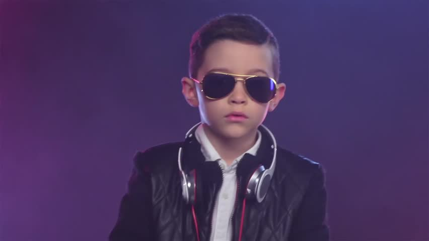 Serious look through the glasses from stylish boy. Slow motion | Shutterstock HD Video #27098512