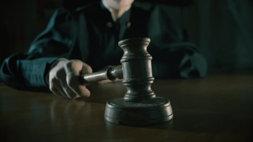 Judge with a hammer in his hand in the court room | Shutterstock HD Video #27099700