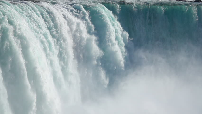 SLOW MOTION, CLOSE UP: Powerful raging whitewater waterfall falling forcefully over a rocky edge. Crystal clear glacier water stream dropping over the cliff. Misty majestic Niagara Falls river rapids #27121114