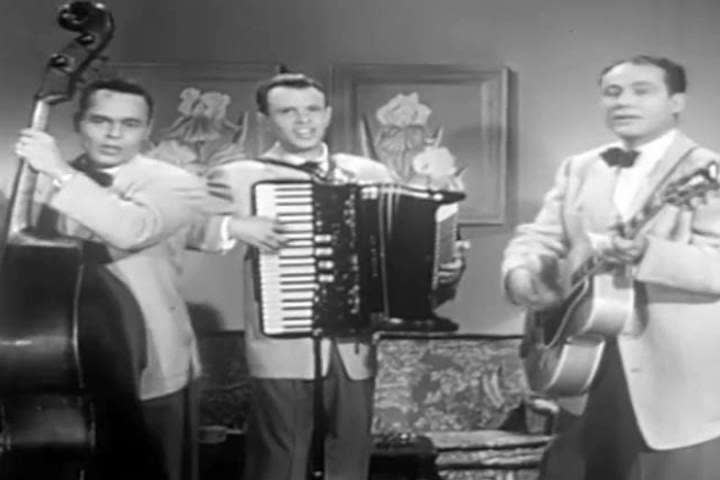 1950s: A folk trio play old standards in this 1950s soundie musical.
