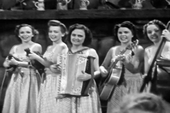 1940s: In this odd 1940s soundie musical number we are transported to a 1940s bar where women sing about the world being flat, as well as themselves.