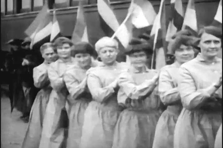 1920s: Women suffragists arrive in a train and parade through the streets, in a demonstration for voting rights, in 1920.