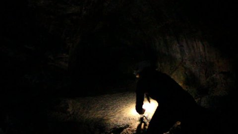 Lava Caves 14 woman gets in small hole