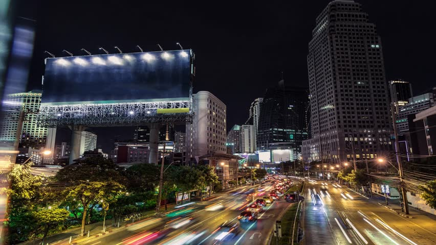 4K resolution Timelapse Cinemagraph, The Big blank billboard beside the road at night, Advertising background for add your text promotion or product in scene traffic communication Royalty-Free Stock Footage #27222178