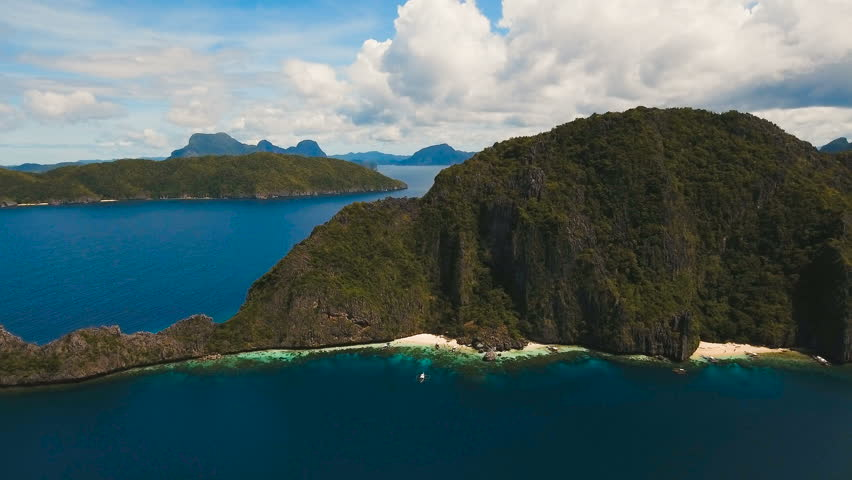 Tropical islands, aerial view. Aerial view: sea and the tropical island. Tropical bay in El Nido. Archipelago El Nido.Sandy beaches of the wild islands. Philippines National Marine Park. Aerial video | Shutterstock HD Video #27228730