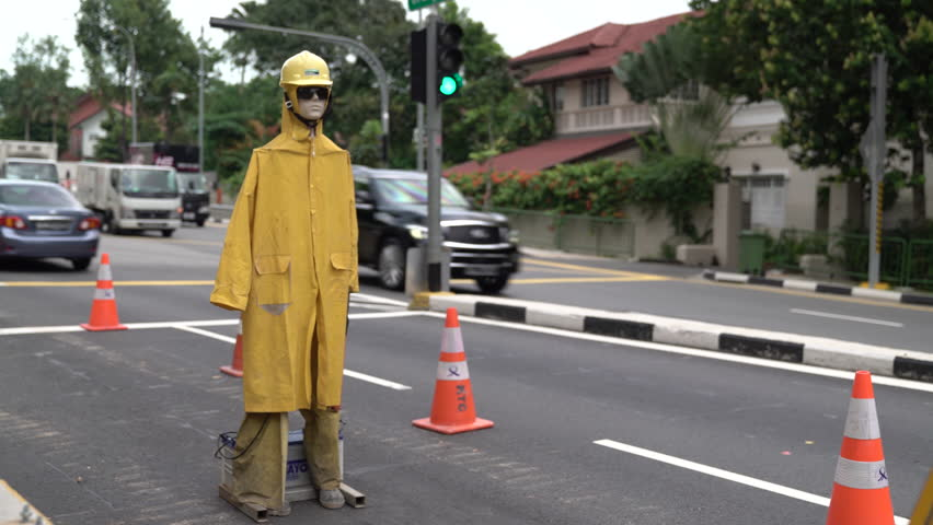 SINGAPORE - 18th April 2017: 'Robot' directing traffice at Grange Road construction
