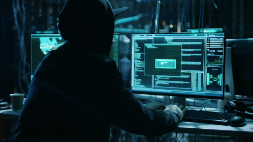 Team of Internationally Wanted Teenage Hackers Infect Servers and Infrastructure with Ransomware. Their Hideout is Dark, Neon Lit and Has Multiple Displays. Shot on RED EPIC-W 8K Helium Cinema Camera.