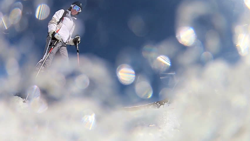 Downhill skier performing a maneuver on the slopes | Shutterstock HD Video #2724590