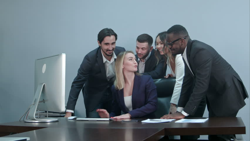 Group of multiracial businesspeople together videoconferencing at workplace