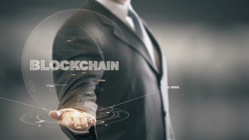 Blockchain with hologram businessman concept Royalty-Free Stock Footage #27257809