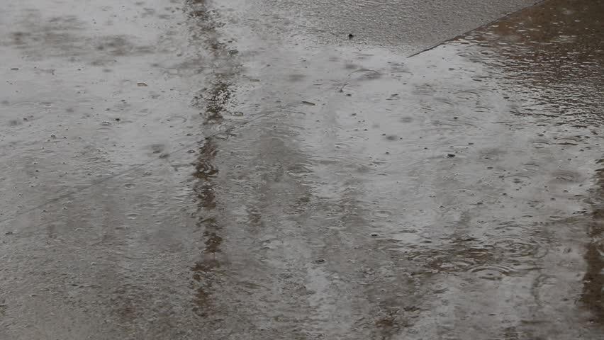Closeup of Rain on Sidewalk | Shutterstock HD Video #27262978