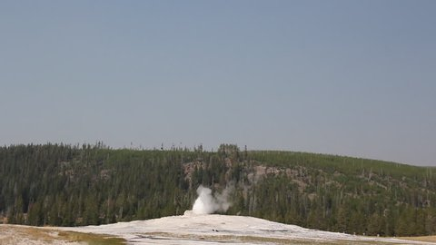 Old faithful hot spring at yellow stone national park