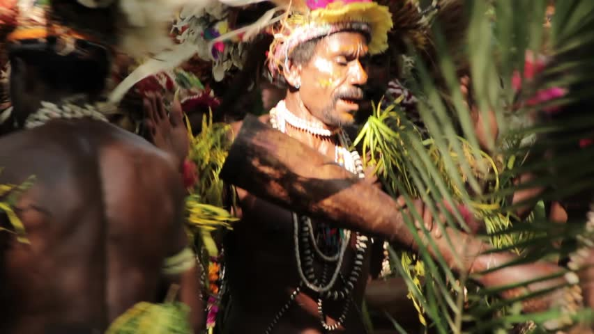 TUFI, PAPUA NEW GUINEA - APRIL 8: Elaborate and detailed traditional costumes adorned with feathers, flowers and shells are worn by traditional dancers on April 8, 2011 in Tufi, Papua New Guinea.