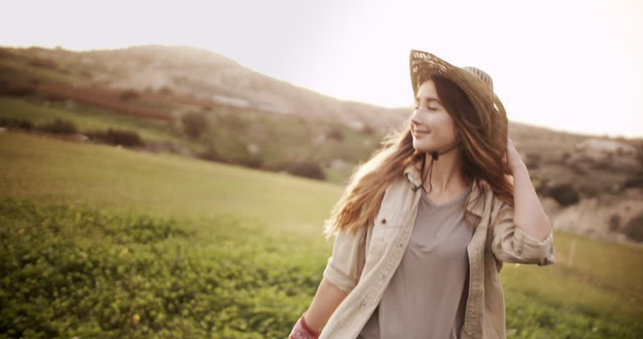 Young beautiful woman in country style walking in a green meadow in a farm   Shutterstock HD Video #27277264
