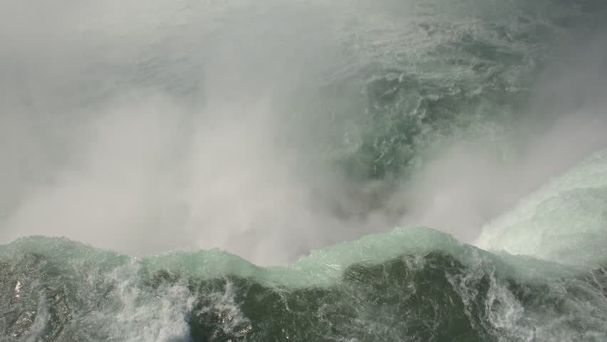 AERIAL CLOSE UP: Flying above the raging whitewater river and over the edge of Niagara falls, tilting down towards the misty bottom. TOP-DOWN aerial view of Horseshoe falls in Niagara river. | Shutterstock HD Video #27283126