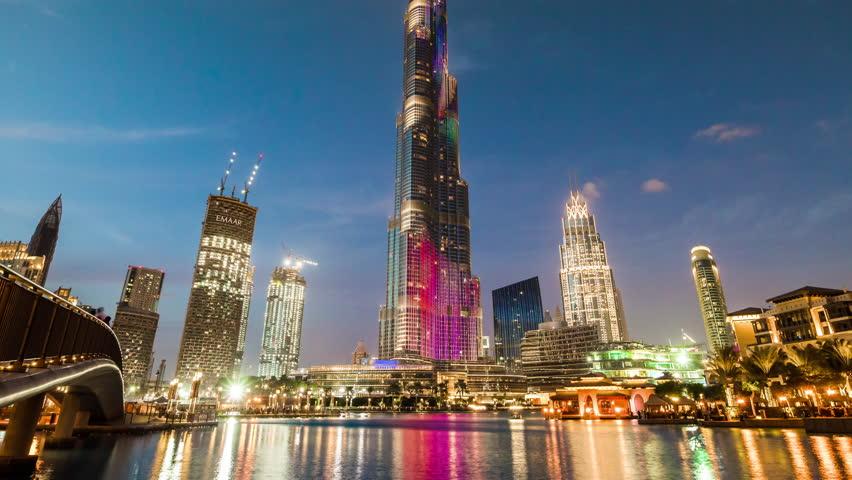Sunset night downtown dubai famous burj khalifa fountain show panorama 4k time lapse uae