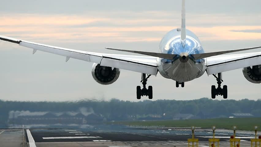 Huge passenger airplane landing close up