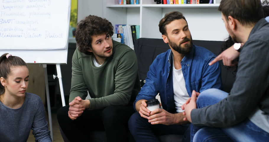 Young business team to develop new ideas for new projects in the office   Shutterstock HD Video #27337816