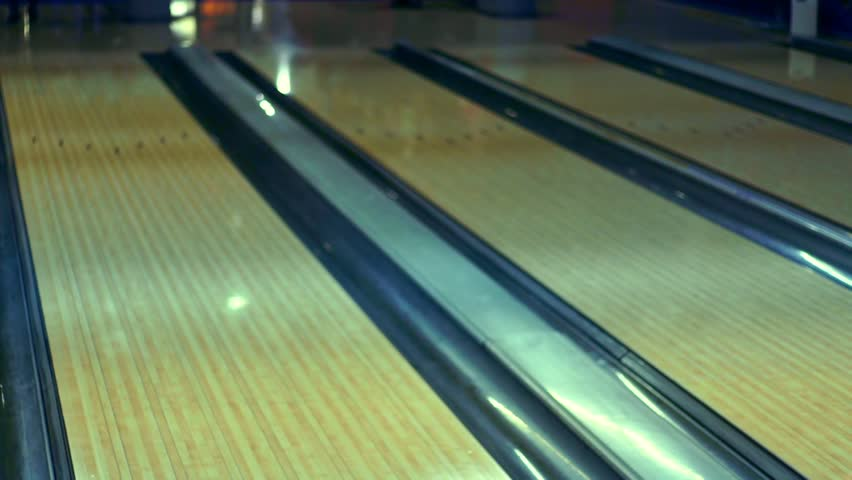 Bowling ball on bowling alley slow motion. Close up bowling ball on bowling lane wood