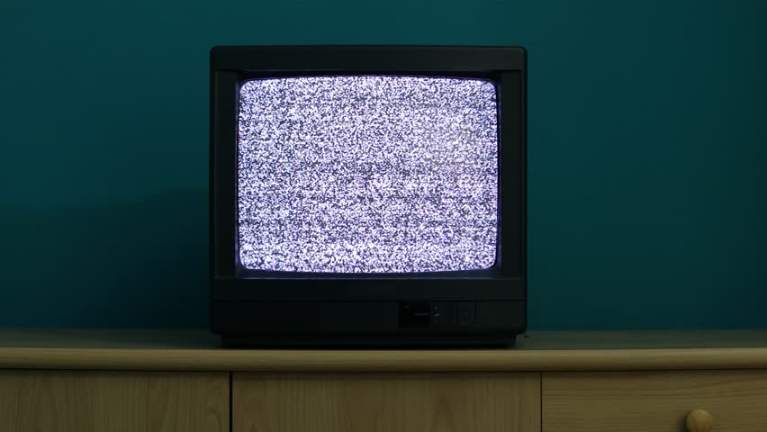 No reception just noise on an old TV in a dim room | Shutterstock HD Video #27350194